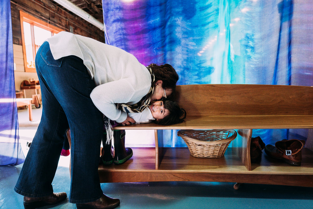 Grandma kissing grandkid. Metro Detroit Plymouth Family Photographer.