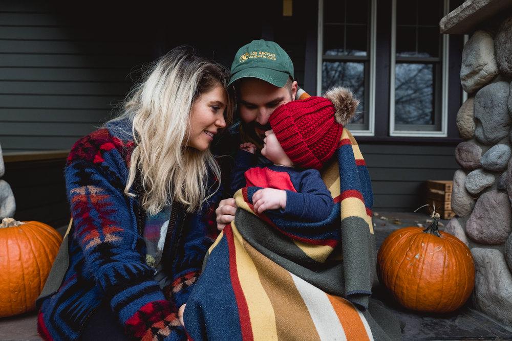 Family on fall decorated porch. Metro Detroit Royal Oak Family Photographer.