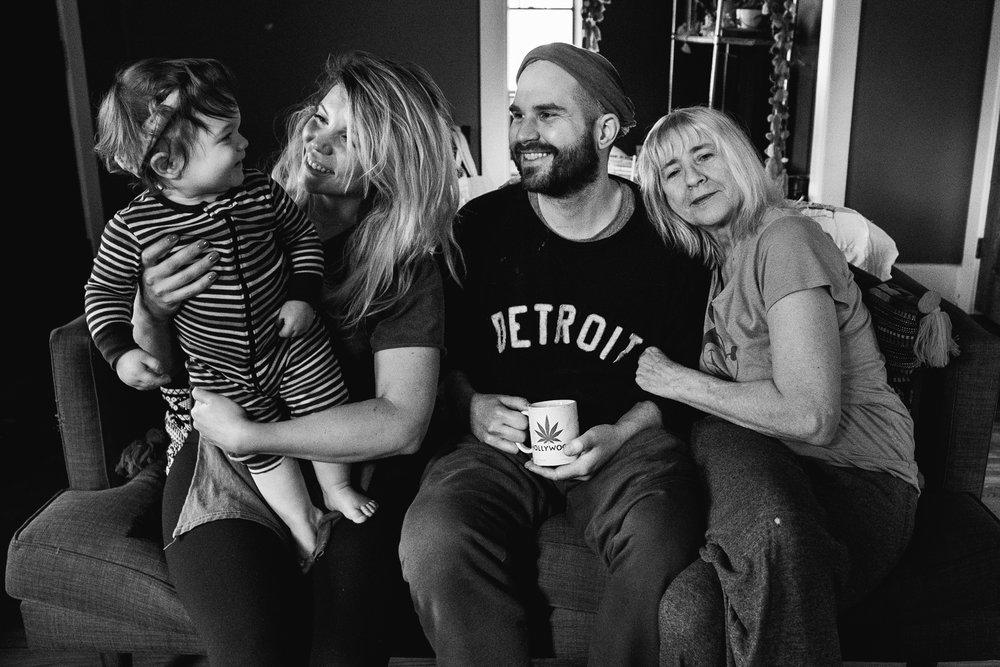 Family photo in living room. Metro Detroit Royal Oak Family Photographer.