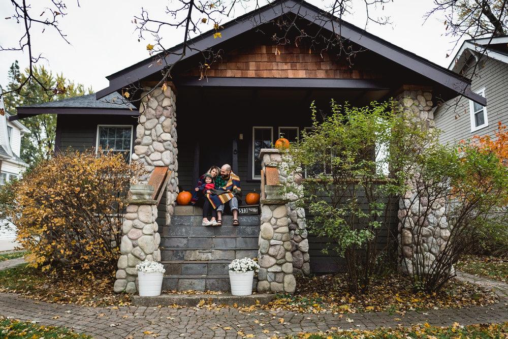 Awesome Royal Oak house, family on porch. Metro Detroit Royal Oak Family Photographer.