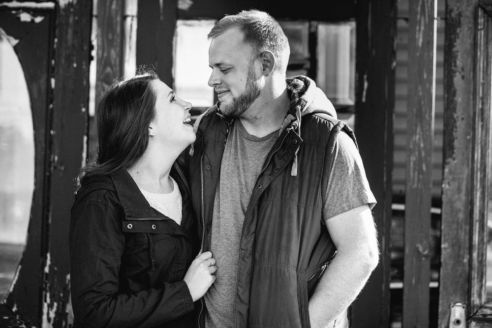 Wife gazing at husband. Metro Detroit Royal Oak Engagement Photographer.