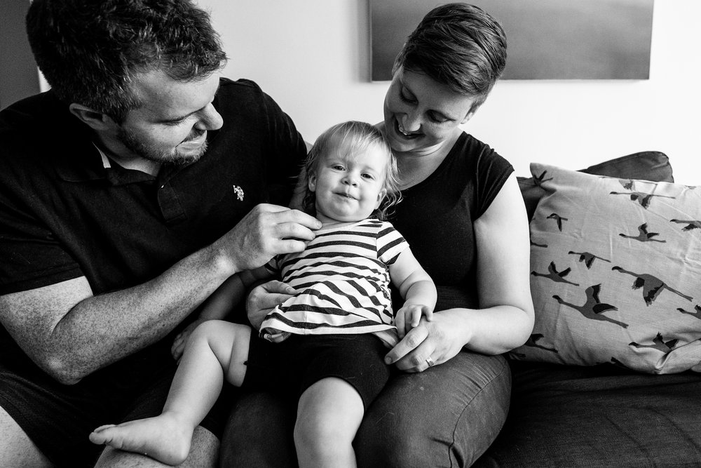 Expecting Family sitting with toddler. Detroit Family Photographer