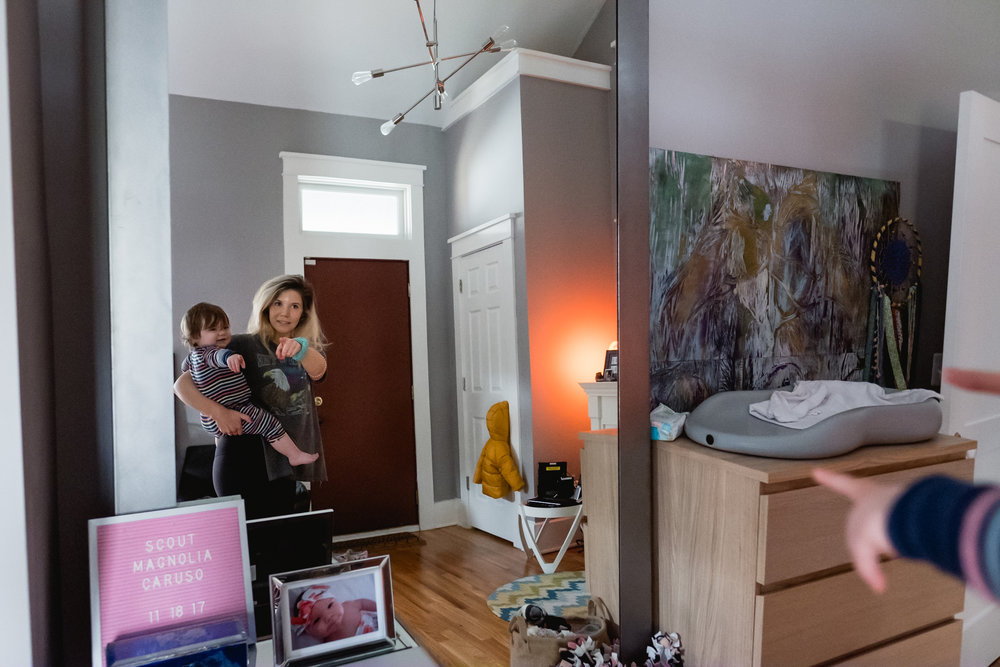 Mama and baby pointing in mirror. Royal Oak Family Photographer. Detroit.