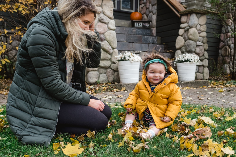 Playing in the leaves with the wind blowing. Royal Oak Family Photographer. Detroit.