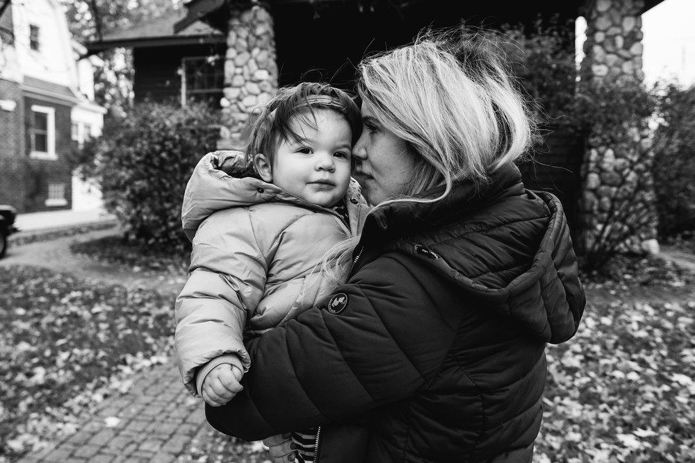 Baby snuggling mama outside. Royal Oak Family Photographer. Detroit Family Photographer.
