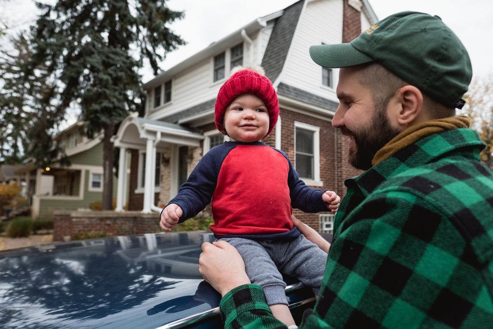 Sitting on daddy's car. Royal Oak Family Photographer. Detroit Family Photographer.