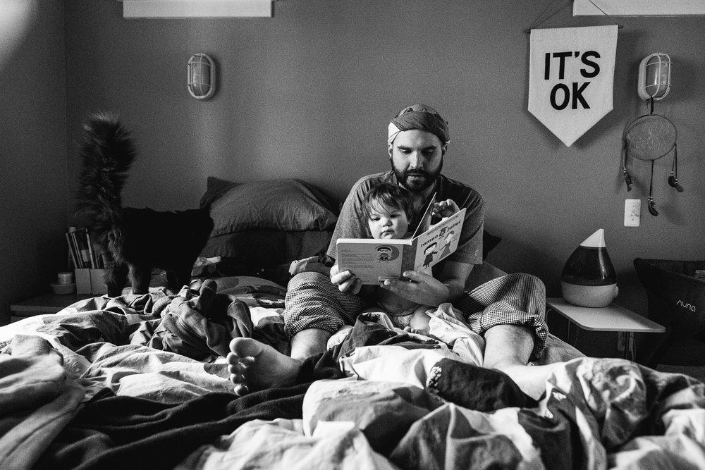 Reading books in bed. Royal Oak Family Photographer. Detroit Family Photographer.