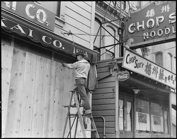 San Francisco, California. With the the owner scheduled to be evacuated, a store front is boarded on Post Street, San Francisco, California.