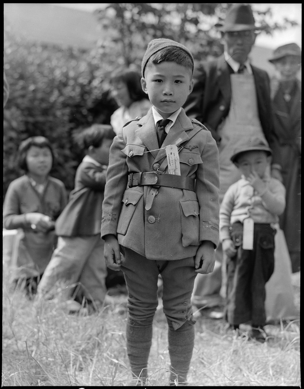 May 9, 1942 — Centerville, California. This youngster is awaiting evacuation bus. Evacuees of Japanese ancestry will be housed in War Relocation Authority centers for the duration.