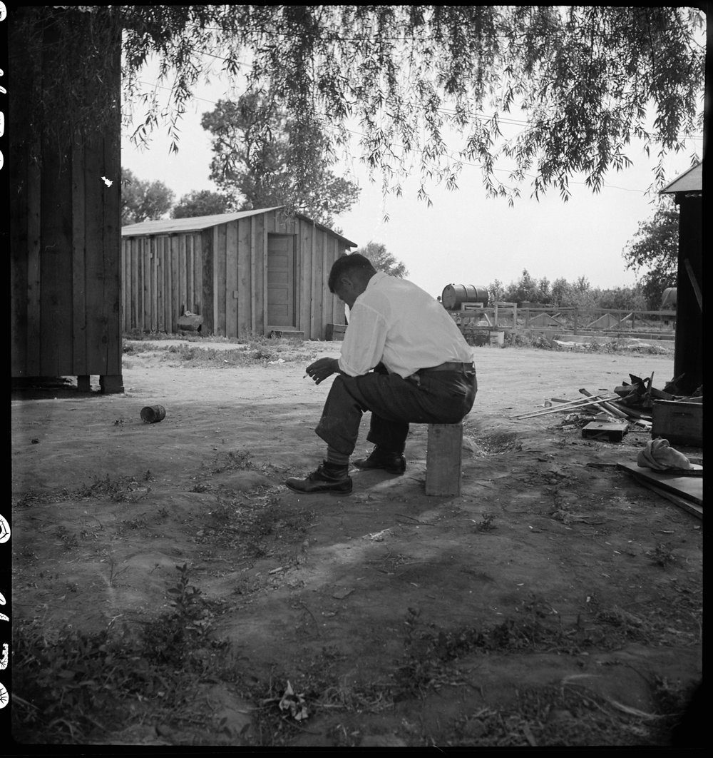 PRINT AVAILABLE May 20, 1942 — Woodland, California. Tenant farmer of Japanese ancestry who has just completed settlement of their affairs and everything is packed ready for evacuation on the following morning to an assembly center.