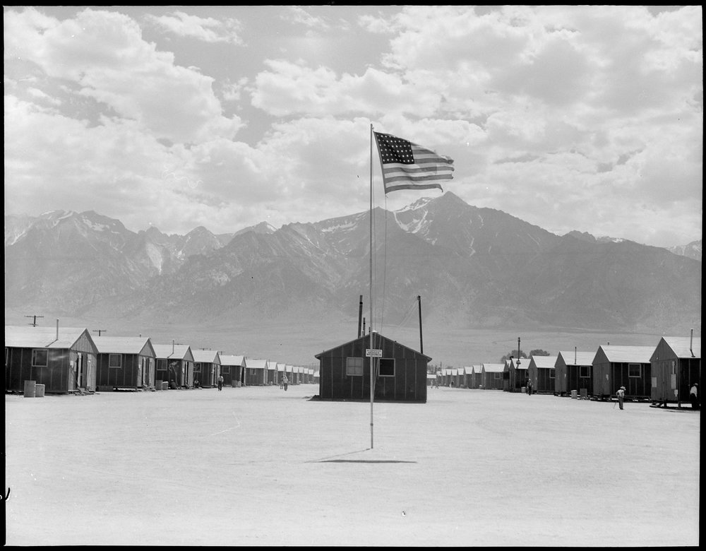 PRINT AVAILABLE July 3, 1942 — Manzanar Relocation Center, Manzanar, California. Street scene of barrack homes at this War Relocation Authority Center. The windstorm has subsided and the dust has settled.