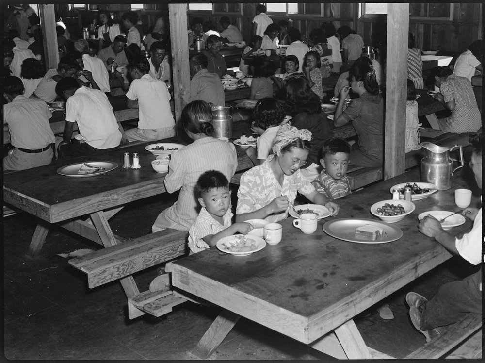 July 2, 1942 — Manzanar Relocation Center, Manzanar, California. Mealtime in one of the messhalls at this War Relocation Authority center for evacuees of Japanese ancestry.