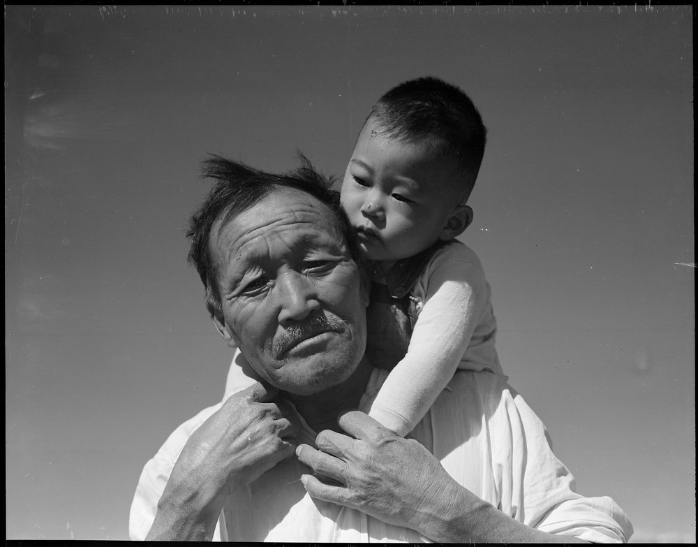 July 2, 1942 — Manzanar Relocation Center, Manzanar, California. Grandfather and grandson of Japanese ancestry at this War Relocation Authority center.