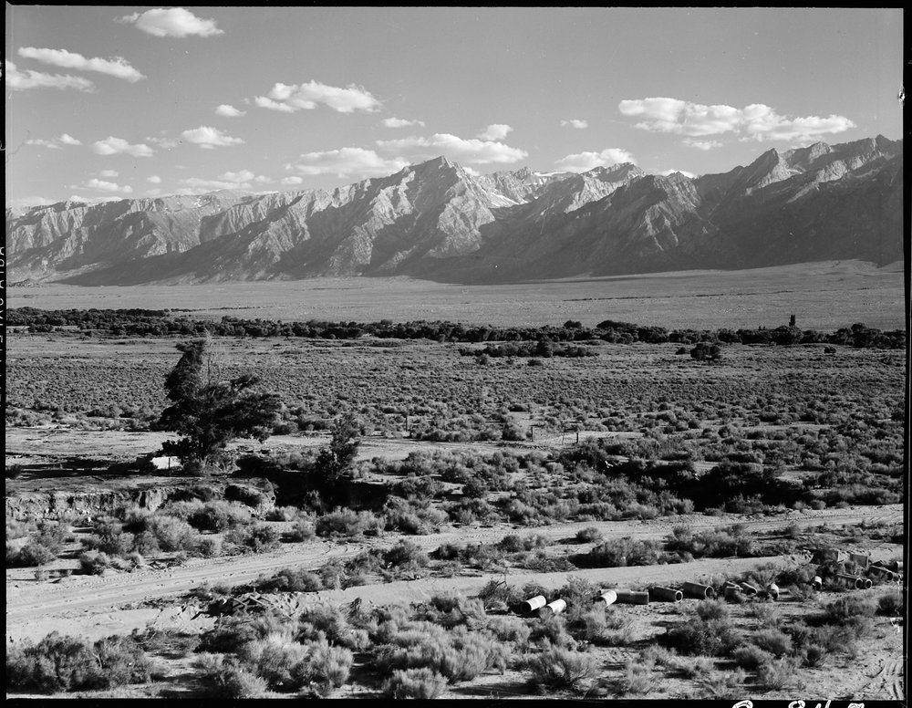 June 30, 1942 — Manzanar Relocation Center, Manzanar, California. A view of surrounding country flanked by beautiful mountains at this War Relocation Authority center.