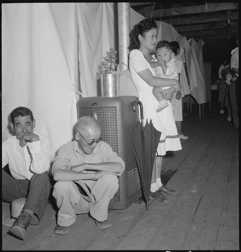 Manzanar Relocation Center, Manzanar, California. A typical interior scene in one of the barrack apartments at this center. Note the cloth partition which lends a small amount of privacy.