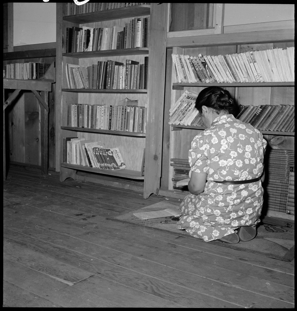Manzanar Relocation Center, Manzanar, California. A corner in the library at this War Relocation Authority center for evacuees of Japanese ancestry. This section contains books in the Japanese lanuage, most of which are translations of English classics.