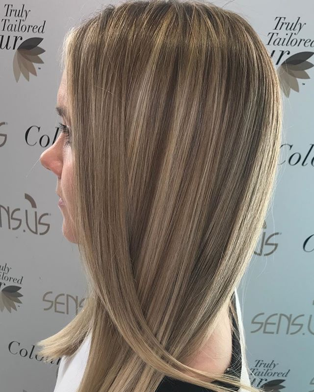 Breaking up a block colour with a full head of highlights, followed by a cut and style.