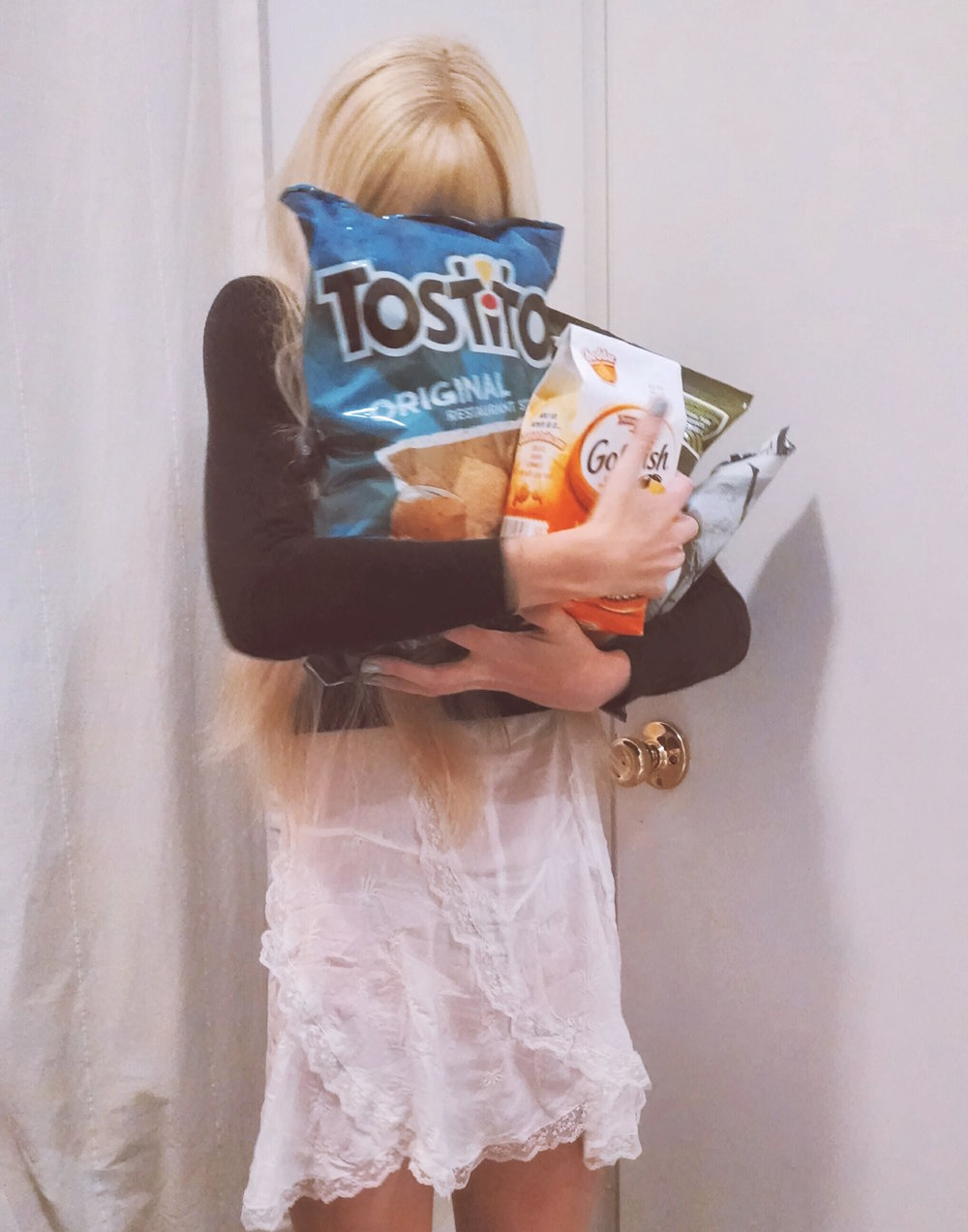 Me in 2013 with tostitos, Goldfish, and two bags of potato chips