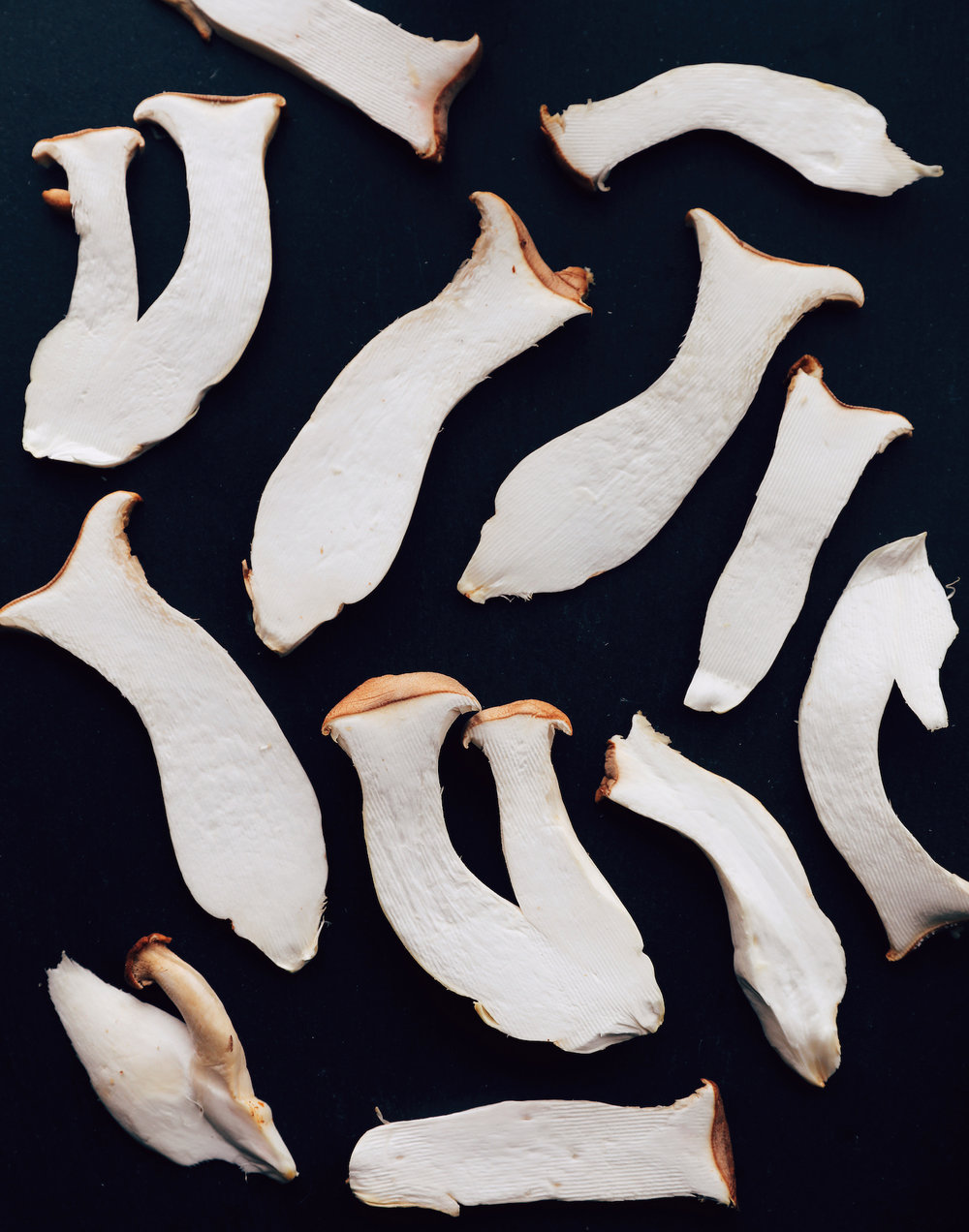 King Oyster mushrooms sliced on a serrated mandoline blade