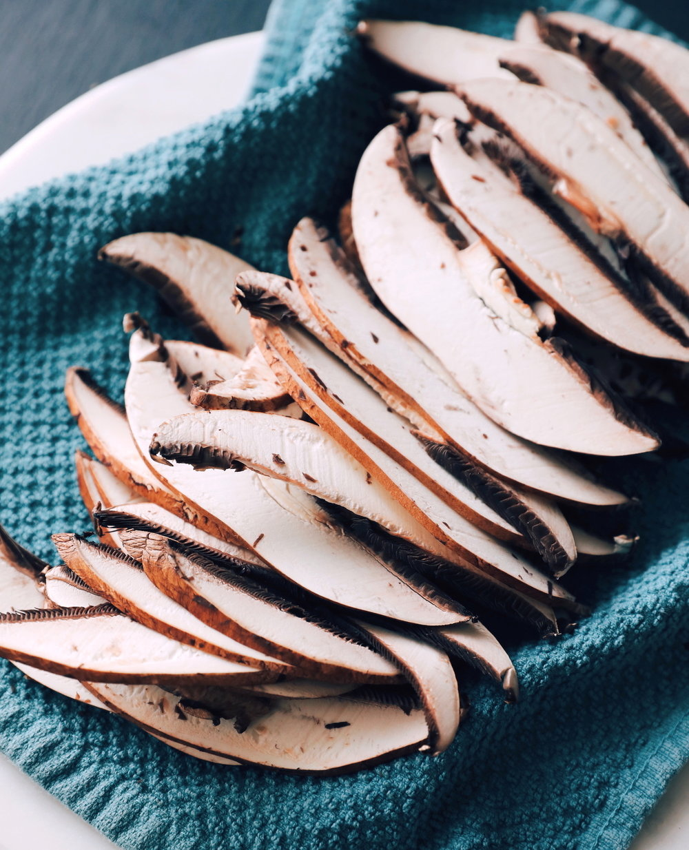Portobello mushrooms thinly sliced with a sharp knife