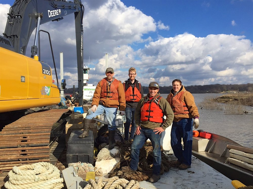 Pictured left to right: John Bradburn, GM; Daniel Kietzer, US BCSD; Chad Pregracke, Living Lands and Waters; and Steve Tullos, Entergy on the Living Lands and Waters barge outside of Memphis, TN.