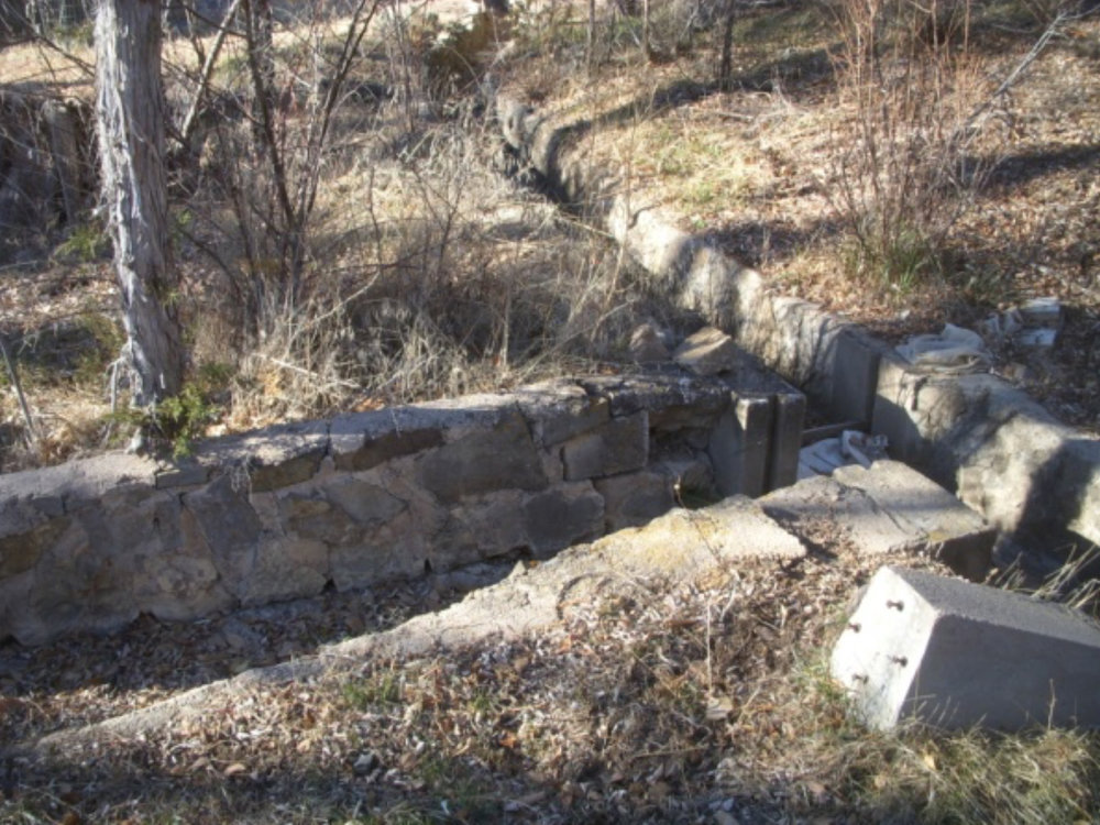 Stonework lining the acequia and entrance to the current lateral at 9 Camino Pequeño.   photo by the Deborah and Jon Lawrence