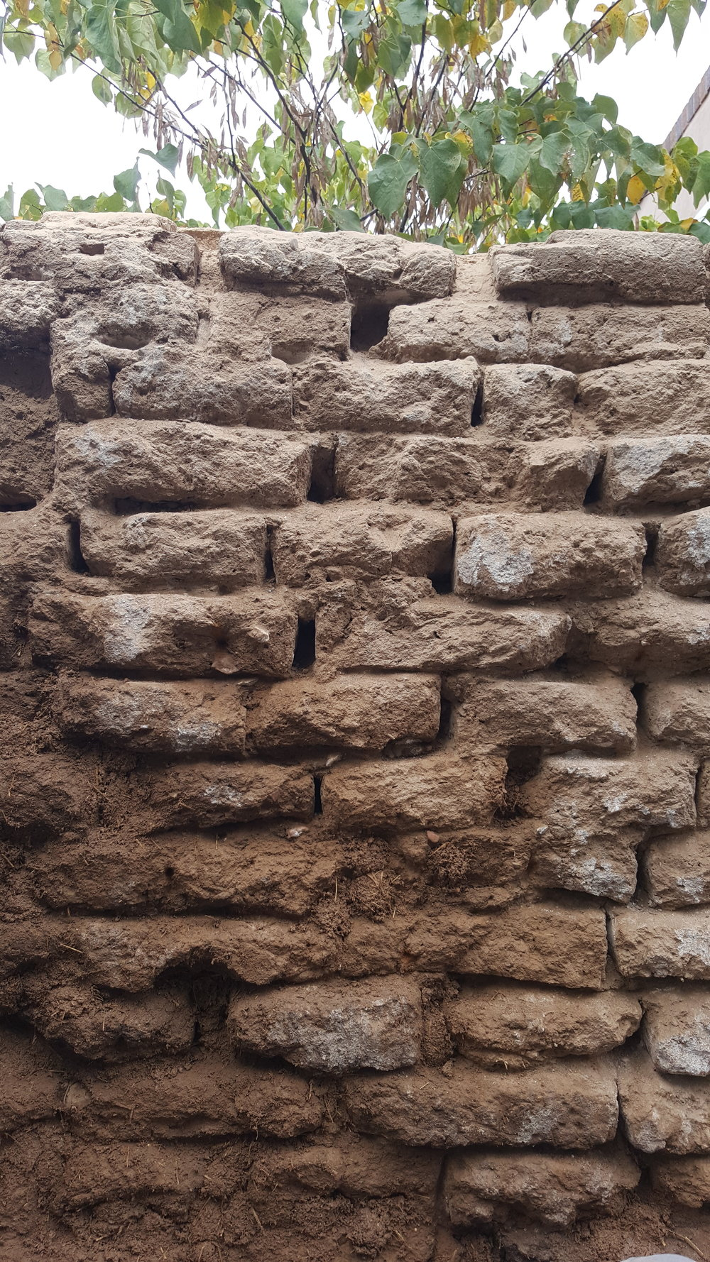 Adobe Wall outside Hsff's El Zaguán on Canyon Road during 2018 repair and restoration