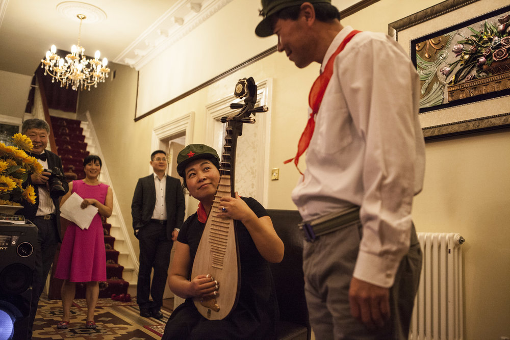 Chinese medicine practitioners Dr. Zhao and Dr. Wang perform a popular song 'The Red Star lights the way for me to go into battle' from a film released during the Cultural Revolution. Dr. Wang plays a pipa (琵琶) - a traditional Chinese lute.