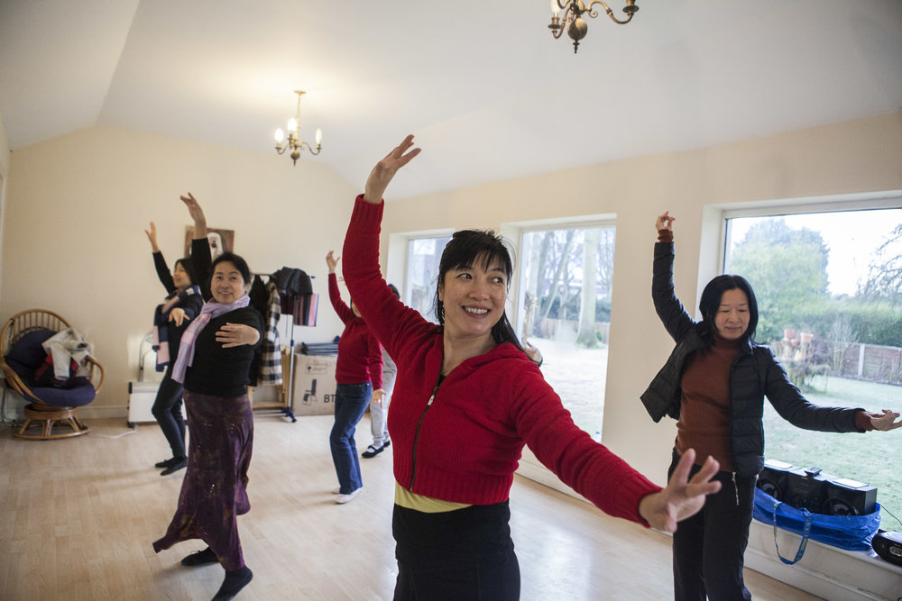 Lanhua Dance Group rehearses in the studio built by Mrs Wang's (centre) husband in their back garden so that she would have somewhere to dance – her childhood dream. In September 2016 the group performed in front of the Birmingham Bull Ring as part of a Multicultural Show.