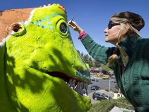 Cheryl Latimer revamping the iconic T-Rex at Peter Pan Mini Golf on Barton Springs Road in Austin Texas