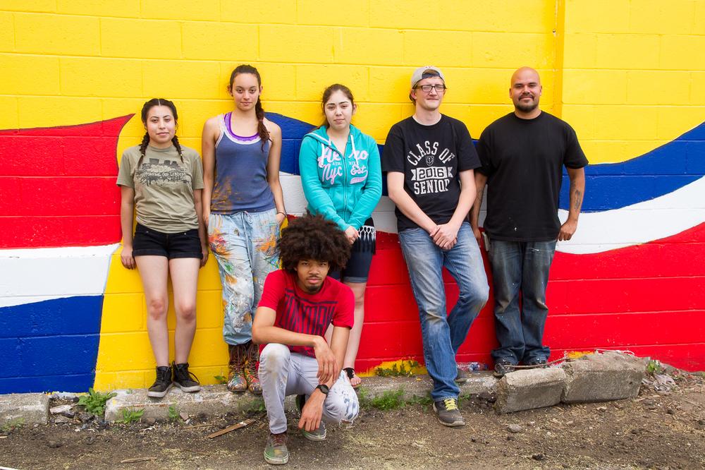 The artists and student volunteers in front of their mural on Granville Ave, June 2016; Erika Lopez, Raquel Silva, Carolina Muñoz, Joseph Hartman, Ricardo Gonzalez, and David Frison.
