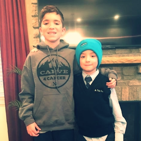 Bobby Burt in his Carve 4 Cancer Hoodie with his little brother, Matthew.