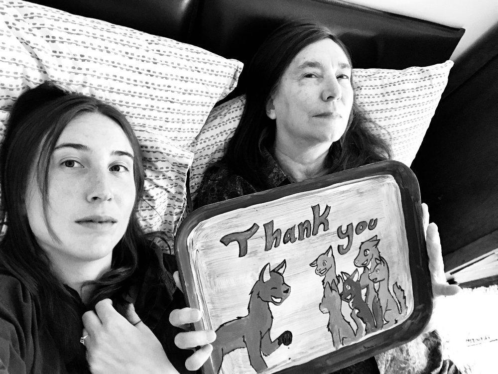 Lili Holzer-Glier and Jenny Holzer, who is holding one of her favorite items, a tray gifted to her by school children as a thank you for visiting their class.