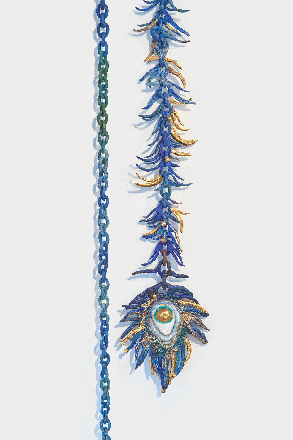 Heidi Lau,  The Blue Peacock,  2018. Ceramics and gold luster, 102 x 8 x 3 cm. Courtesy of Geary.