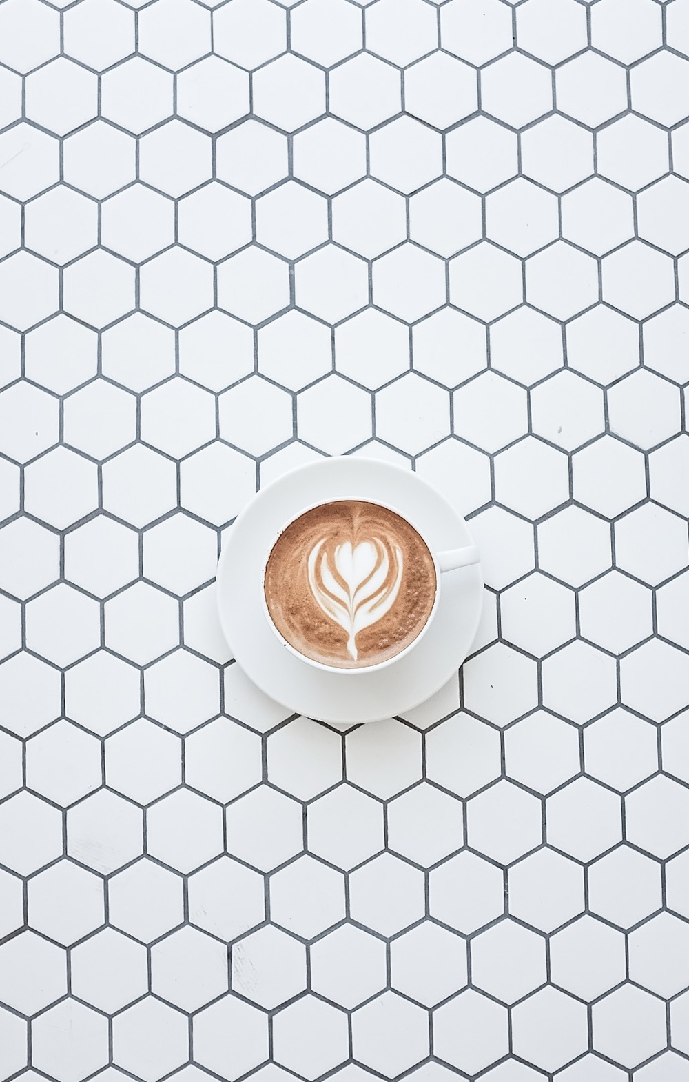 Nice latte art on pretty tiles.
