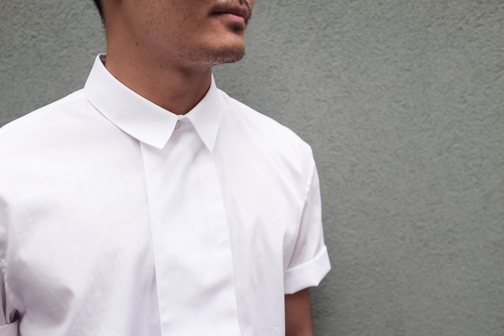 The wider front adds an interesting detail to the white shirt.
