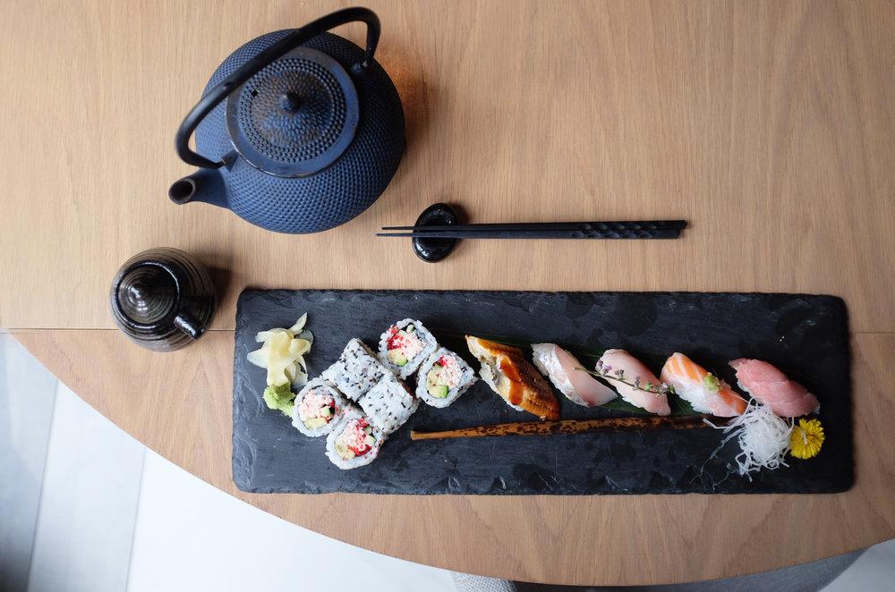 Premium sushi platter including Kasamoto's soft shell crab maki.
