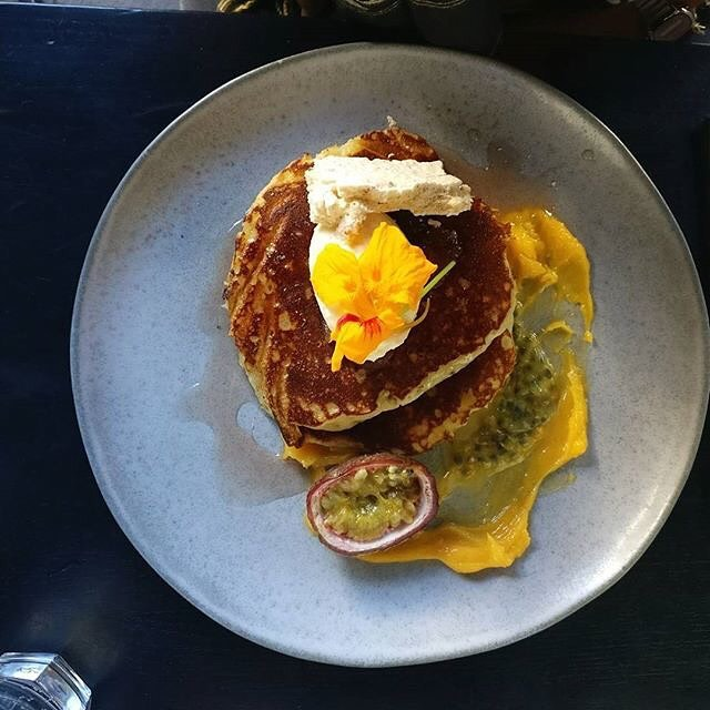 The tried and true ricotta hotcakes. A long serving member of our menu, only changing slightly when the seasons do. At the moment it's passionfruit, lemon curd, and hibiscus. 📷: @alienvoyage