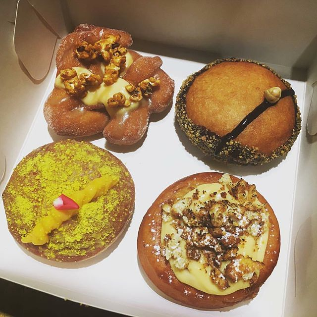 Our new doughnuts! From the top left: Caramel popcorn; Chocolate and Hazelnut; Apple Crumble; Lemon Yoghurt.  Available Monday to Friday 🍩