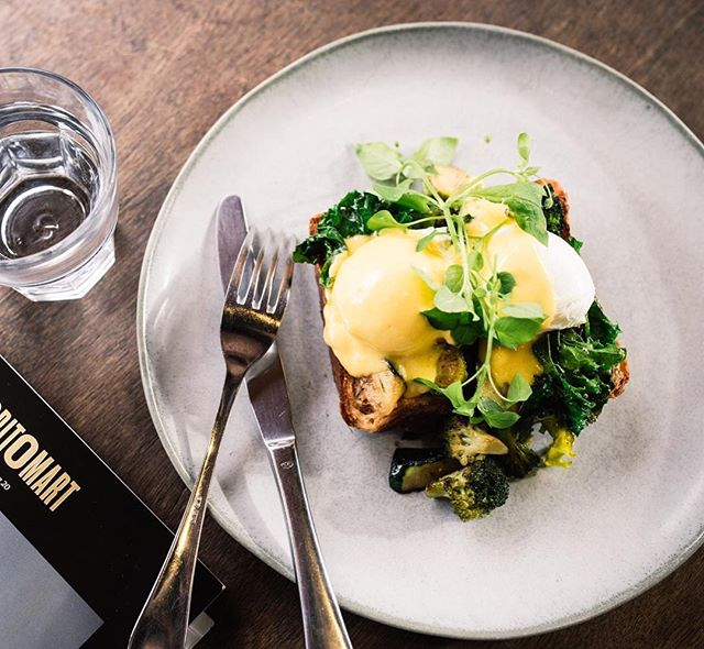 Start your days off with our gorgeous little eggs benedict on toasted brioche loaf, paired here with fresh autumn greens 🌿🍳