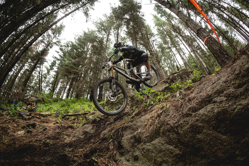 Finn Hawkesby-Brown (16) rock skimming his way down the GC Downhill track at the NZ Open on his way to 6th overall and 1st under 19 rider. Photo | Cameron Mackenzie