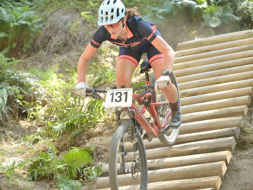 Rebecca Hufflett on her way to the podium at the South Island XC Championships.