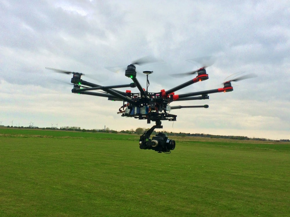 This is our DJI S1000 Octocopter in action.  We have 2 Licensed Drone Pilots on staff, and they work in conjunction with our Professional Photographer/Videographers to offer the highest level of safety and professionalism... so our clients get the exact footage they require with minimal impact on the surrounding environment