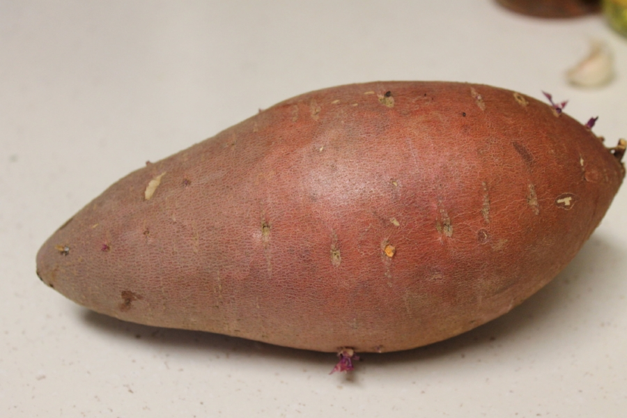 Okay so this guy may have been sitting on my counter for a few weeks. It's little eyes are all purple. Whoops....but at least sweet potatoes (and most root vegetables) can last a lot longer, they are great for that reason.