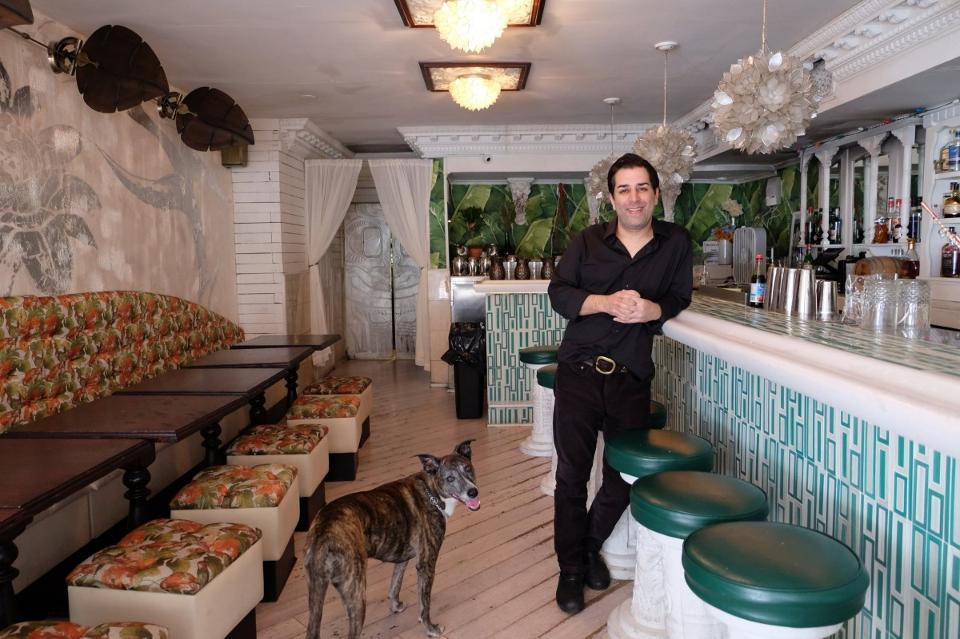 Mother of Pearl Owner Ravi Derossi with Pet Dog in Mother of Pearl Bar Picture.jpg