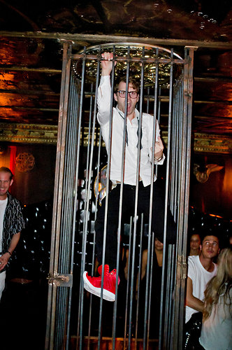 Guy Dancing in The Gin Palace Cage.jpg