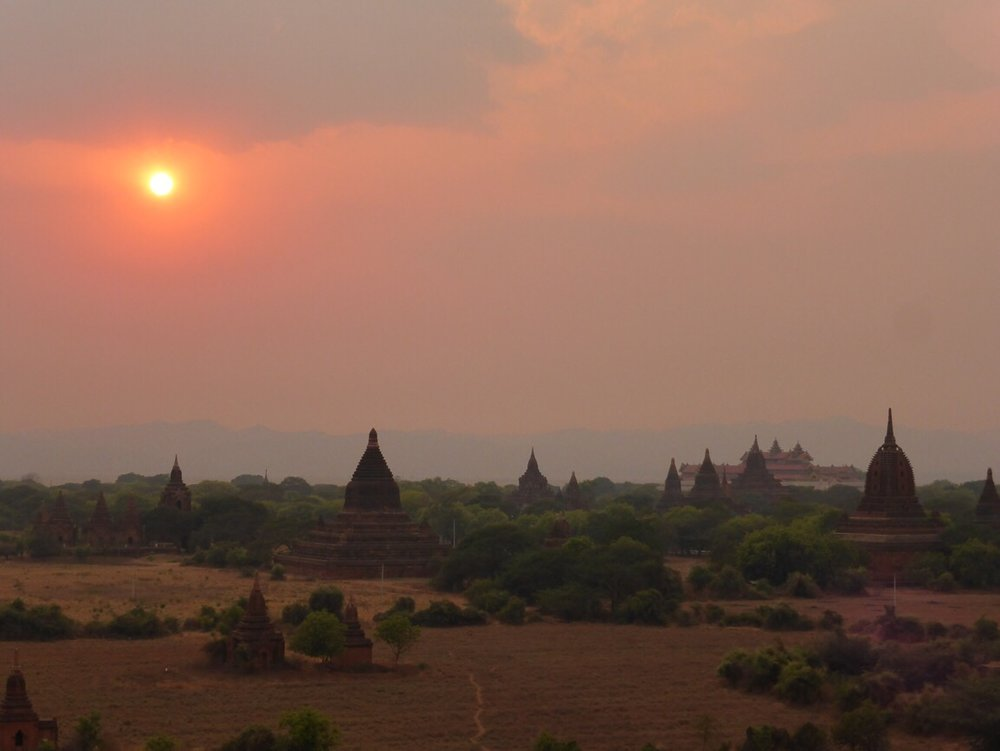 A stunning shot of bagan at sunset from the traveling honeybird