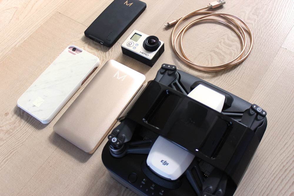 clockwise from top left:  Moyork power bank (from the charge clutch) , gopro hero3,  Moyork lightning cable ,  dji spark  in the  portable charging Station ,  moyork power bank  and iphone 6s with  moyork marble phone case