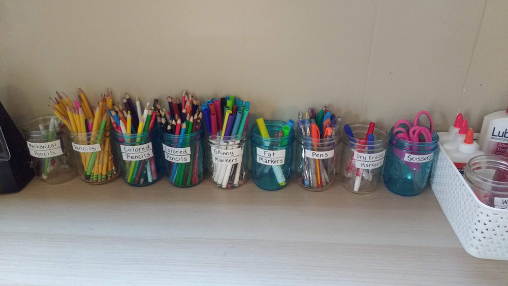 [Image: the girls' desktop supplies organized and set up so they can clean up better on their own.]