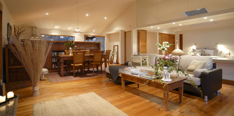 The beautifully appointed lounge with open fire at Clifftops Retreat, Ruby Bay